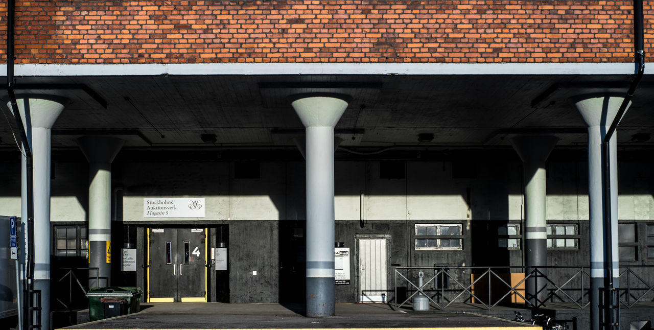 architecture, built structure, building exterior, architectural column, no people, day, transportation, outdoors, parking garage
