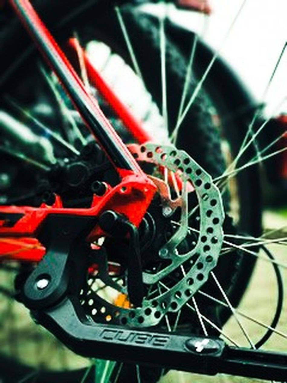 Bicycle Close-up Day Engine Gear Indoors  Industry Innovation Machine Part Manufacturing Equipment Metal Mode Of Transport No People Pedal Red Spoke Steel Technology Transportation Vehicle Part Wheel