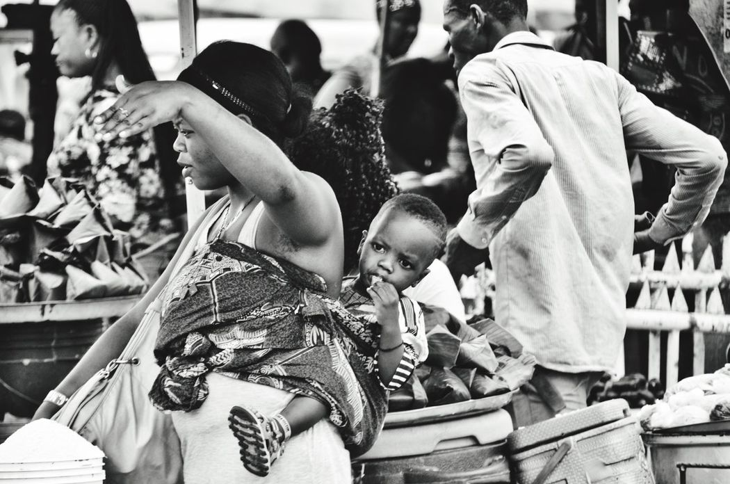 The Street Photographer - 2016 EyeEm Awards The Photojournalist - 2016 EyeEm Awards The Portraitist - 2016 EyeEm Awards Mother and Child - the Street Vendor Series African Mother Africanwoman African Mother And Child Child On Mothers Back Mother Carrying Child Mothers Love Rural Africa African Market Scene Streetphoto_bw Street Traders Street Vendors Strong Black Women