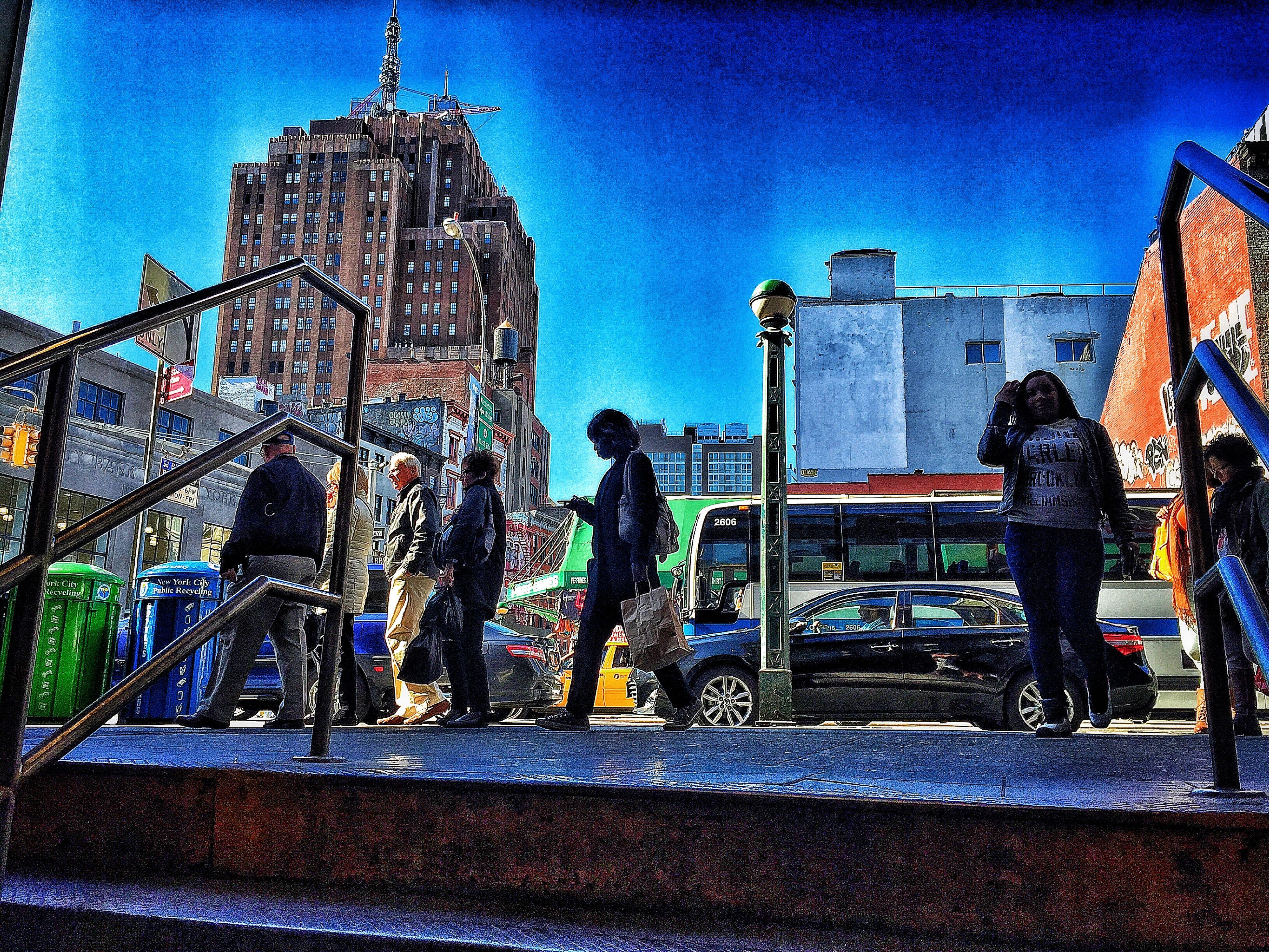 building exterior, architecture, built structure, art, art and craft, sky, blue, lifestyles, human representation, creativity, men, city, leisure activity, statue, street, graffiti, sculpture