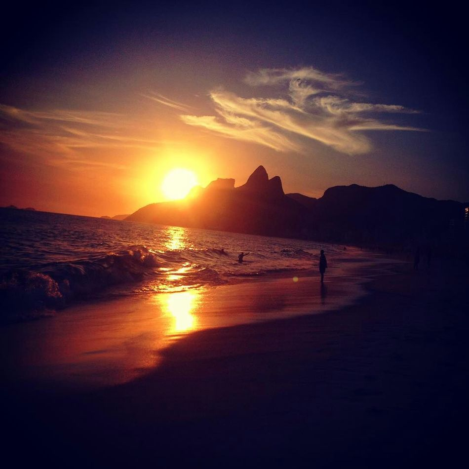 Ipanema sunset Sunset Sea Beach EyeEm Light And Shadow Beauty In Nature Mountain Landscape No People Tropical Climate Ipanema Beach IPhoneography Rio Wonderful EyeEm Gallery Enjoying The Sun On The Beach
