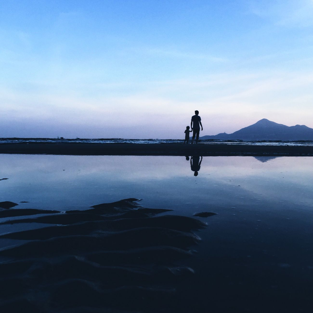 DONGSHAN ISLAND- 旅志 Water Reflection Silhouette Lake Walking Men Tranquility Scenics Tranquil Scene Beach Leisure Activity Standing Mid Distance Beauty In Nature Full Length Vacations Nature Sky Cloud Blue