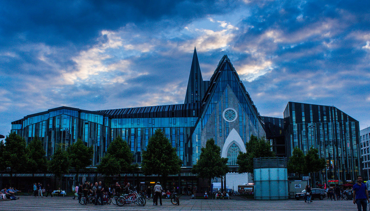 Architecture Building Exterior Built Structure Cloud - Sky Day Large Group Of People Outdoors People Place Of Worship Real People Religion Sky Spirituality Tree