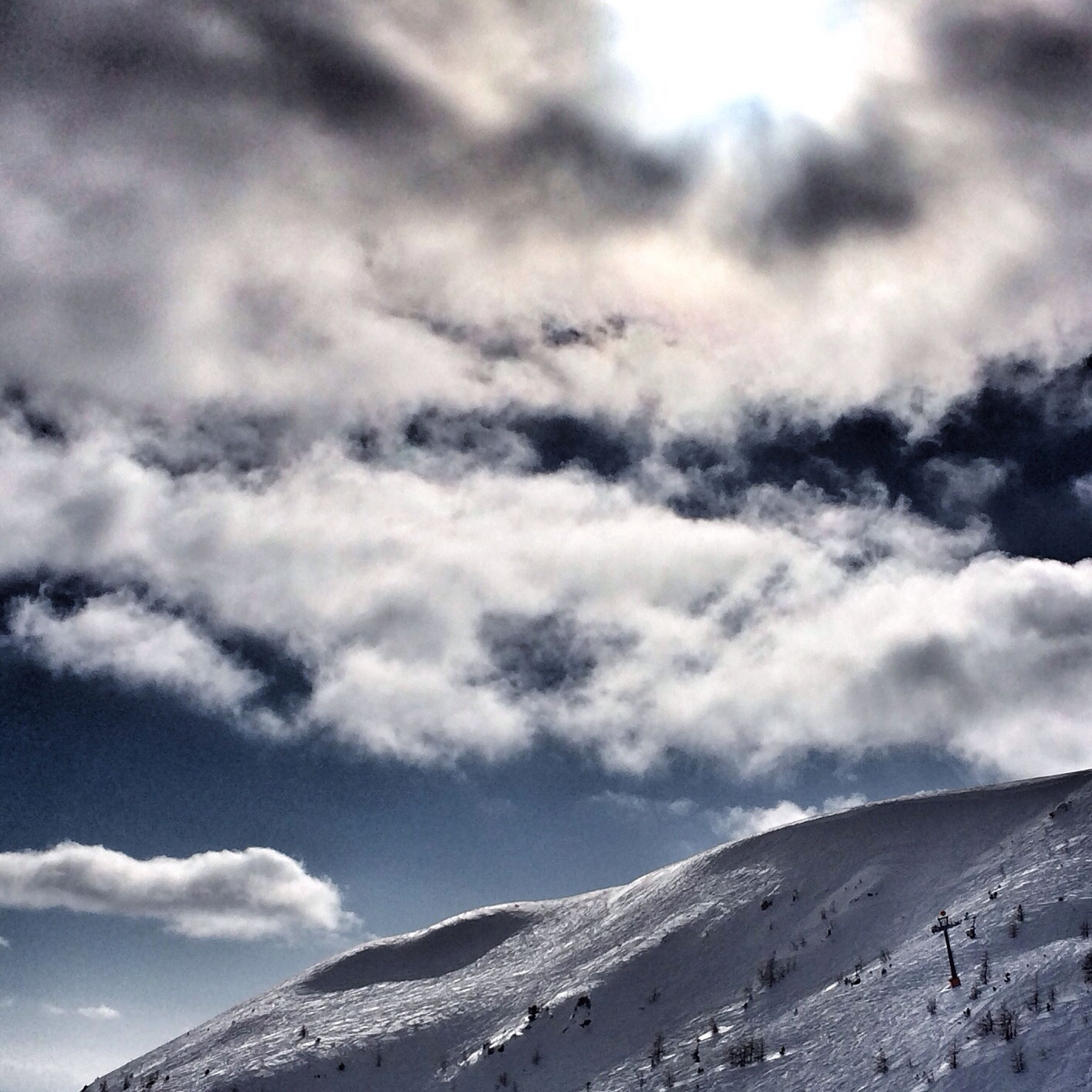 mountain, sky, tranquil scene, scenics, cloud - sky, tranquility, mountain range, beauty in nature, cloudy, landscape, nature, cloud, weather, snow, white color, winter, idyllic, day, non-urban scene, outdoors