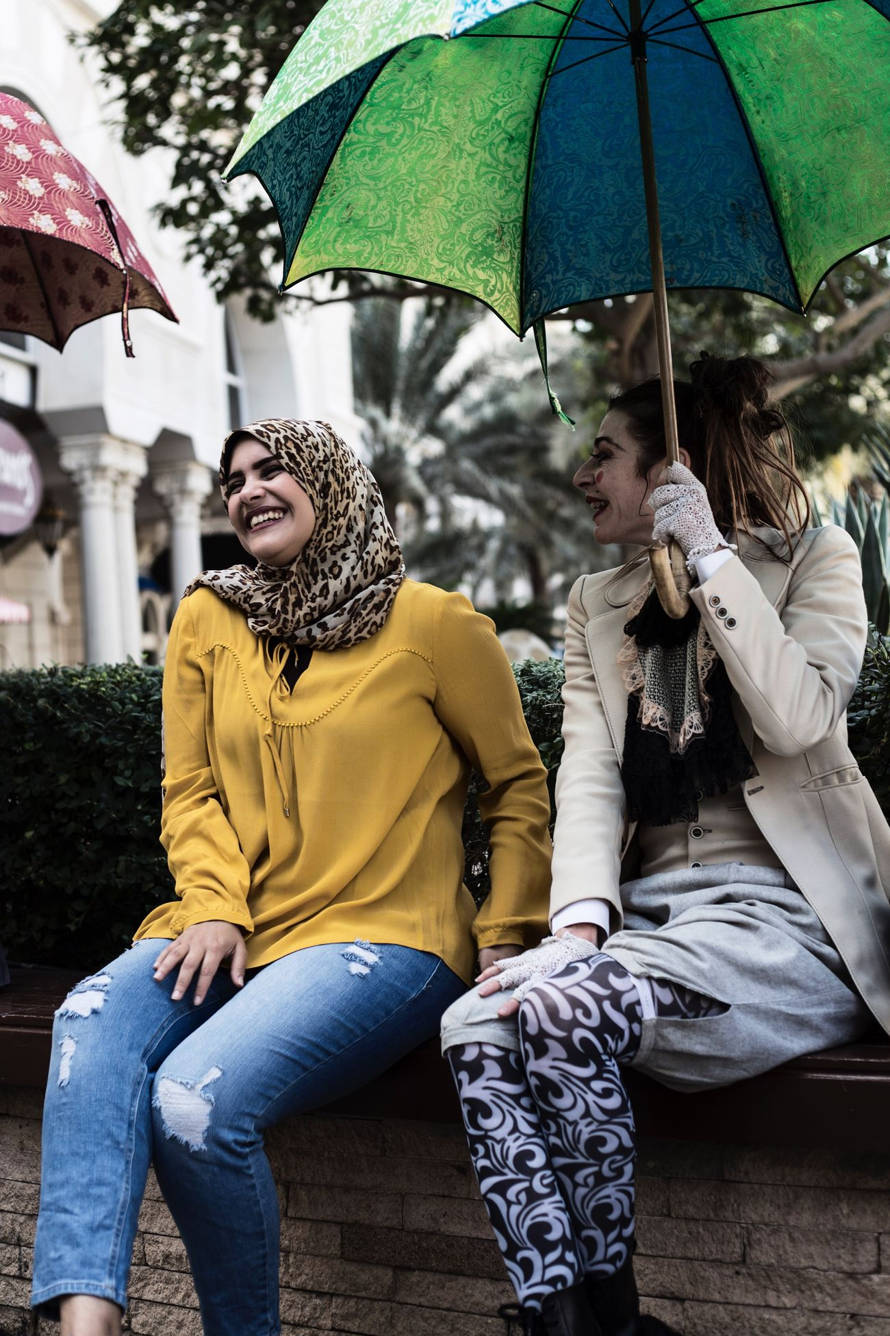 The Street Photographer - 2017 EyeEm Awards Woman laughing during Oposito street show in Sharjah Happiness Young Women Smiling Sitting Cheerful Togetherness Two People Enjoyment Fun Young Adult Day Friendship Women Lifestyles People Outdoors Real People Streetphotography Streetart Street Show Oposito