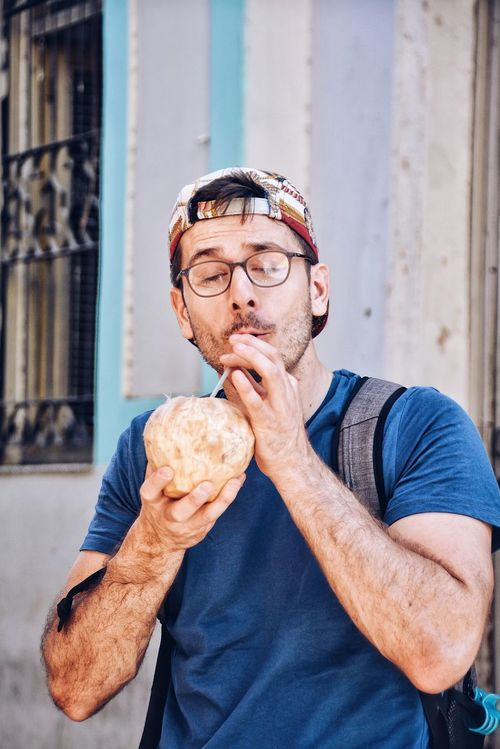 He loves coconut water. Real People Food And Drink People Drinking Drinking Coconut Water Coconut Refreshments Drinks Beach Drinks Warm Weather Warm Day Fresh Freshness Natural Organic Pleasure Pleasures Of Life Pleasant Tourist Cuba Connected By Travel Food Stories