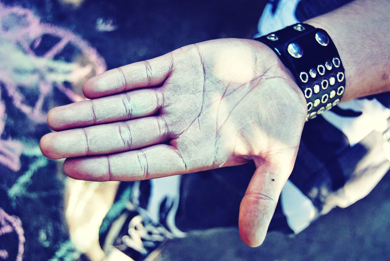human hand, human body part, real people, one person, human finger, close-up, outdoors, day, men, holding, human, people