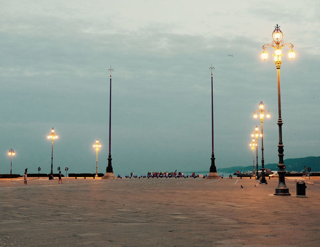 Cloud Electric Light Floodlight Gas Light Holiday Illuminated In A Row Lamp Post Lighting Equipment Scenics Sea Sky Square Squareinstapic Street Street Light Sun Tall Tourism Tranquil Scene Tranquility Travel Traveling Trieste TriesteSocial