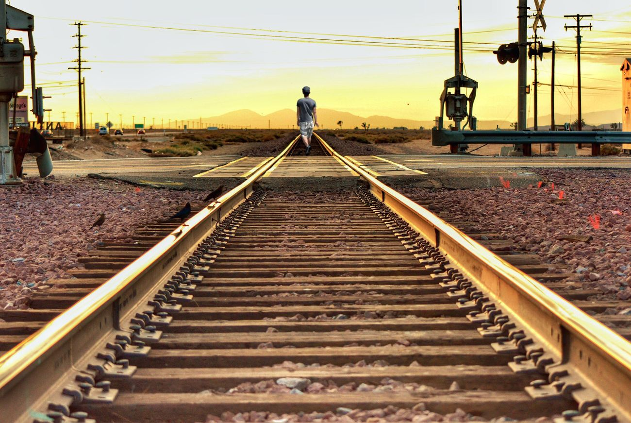 A journey to nowhere Railroad Track Transportation Rail Transportation Electricity  Outdoors Sky Men Electricity Pylon Day People