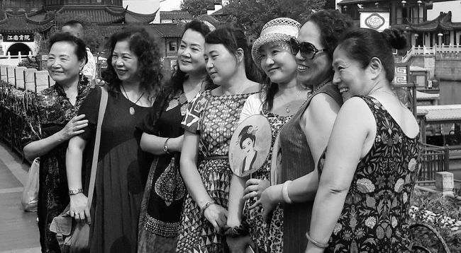 I was so taken away by these incredible women. So much life and happiness in their expression. EyeEm Best Shots Blackandwhite Photography Shades Of Grey Popular Photos Lifestyles Happiness My Best Photo 2016 Amazing People Urbanphotography Eyemphotography China Nanjing China Streets Togetherness Young Women Friendship Leisure Activity Standing Love Lifestyles Bonding Monochrome Photography Celebration Popular Photo