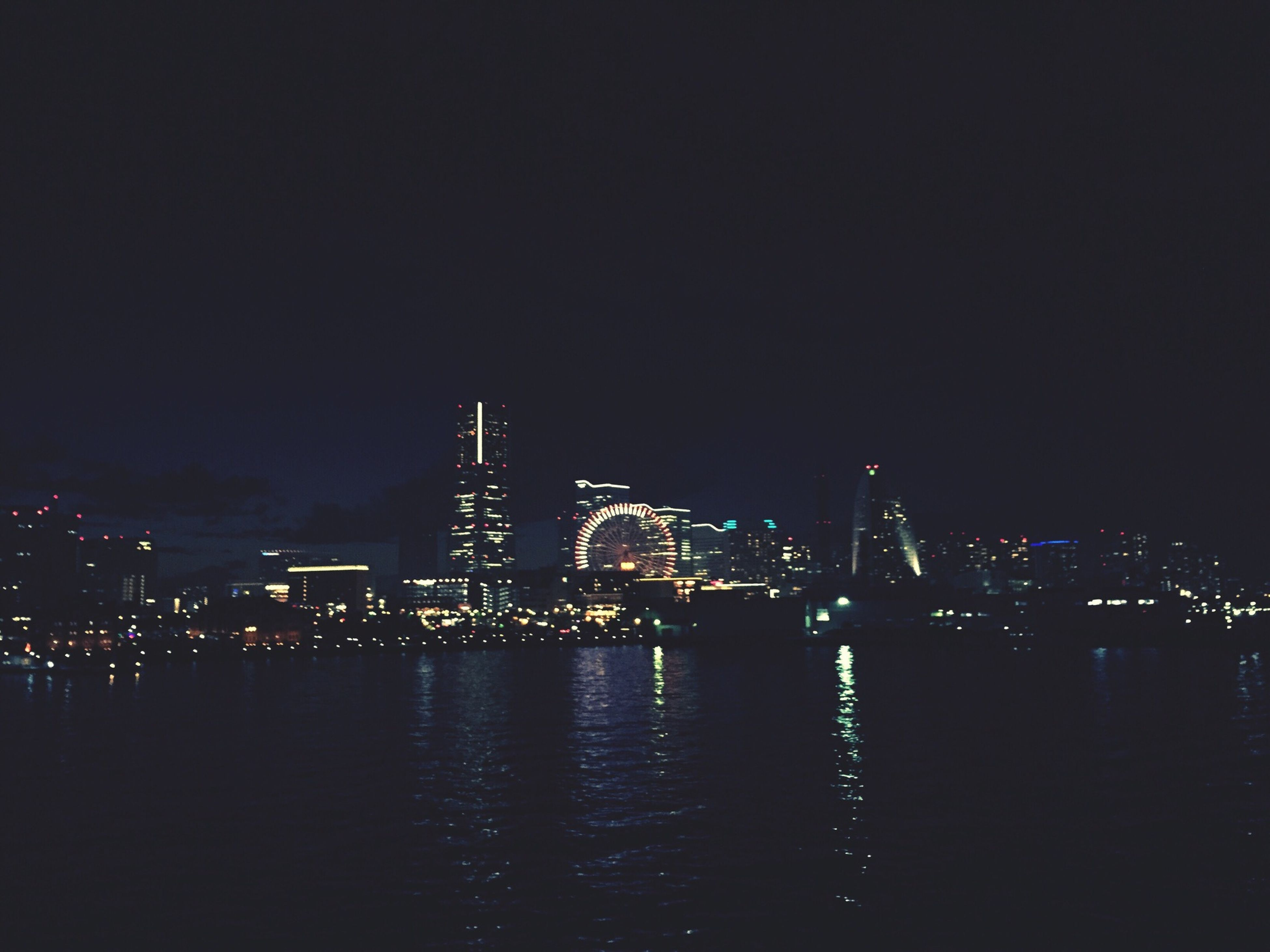 night, illuminated, water, waterfront, architecture, built structure, city, reflection, river, building exterior, copy space, clear sky, sky, cityscape, dark, bridge - man made structure, sea, connection, no people, outdoors