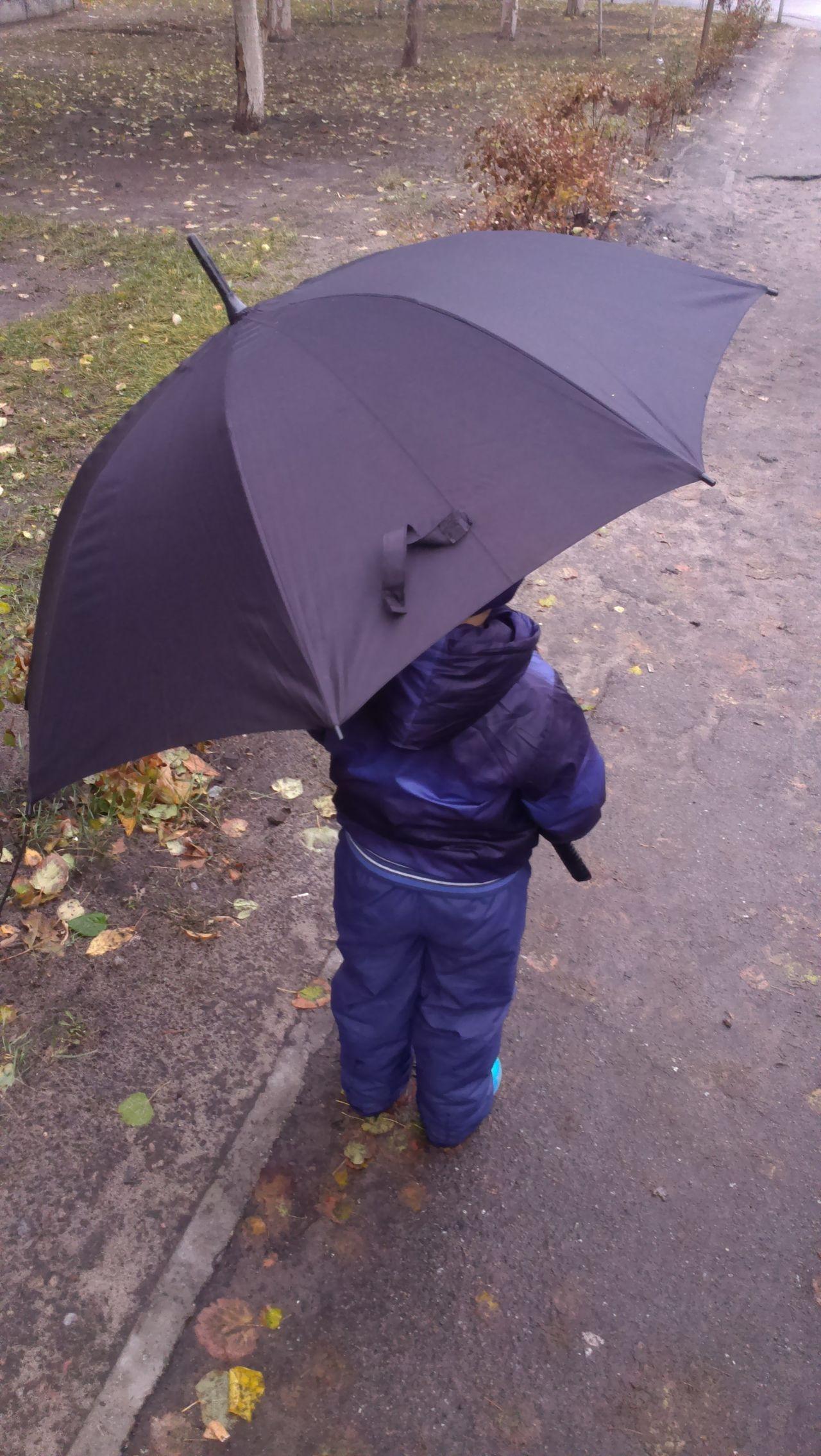 Adapted To The City Kid Kids Kids Being Kids Kids Photography Kidsphotography Rain Rainy Day Weather Weather Photography Weathered