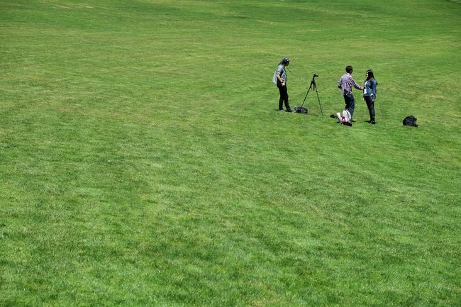 Taking Pictures Of People Taking Pictures Grass Green Field Grassy Landscape Nature Enjoyment Day Outdoors Vacations Running Tranquility Fun via Fotofall