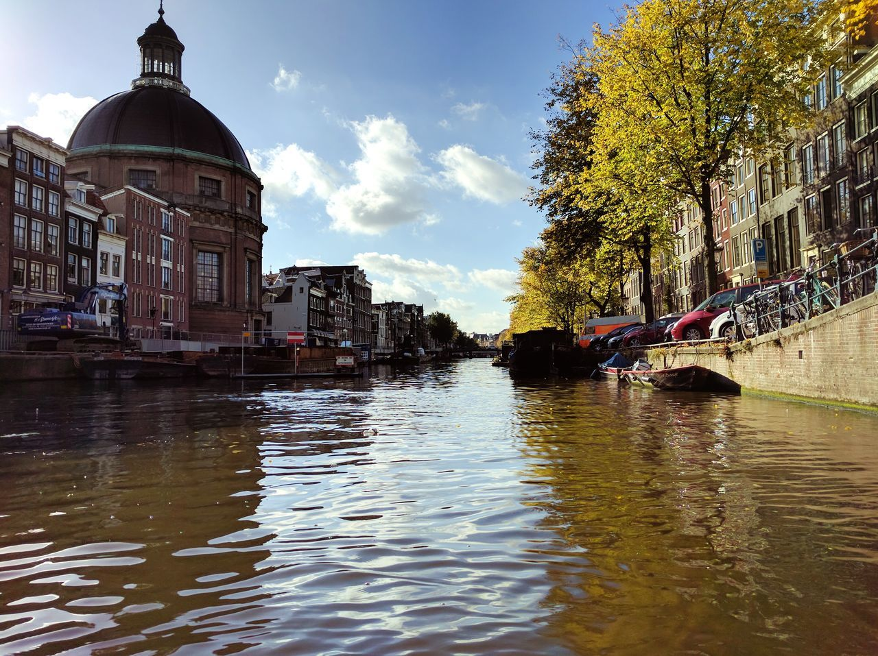 Amsterdam Amsterdam Canal Amsterdam.nl Cruise Cityscape River Boat Architecture Reflection Built Structure Building Exterior City Travel Destinations Sky Water Cloud - Sky Outdoors No People Day