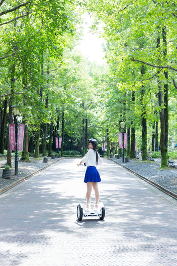 Airwheel Day Full Length Nature Outdoors People Rear View Tree Young Adult