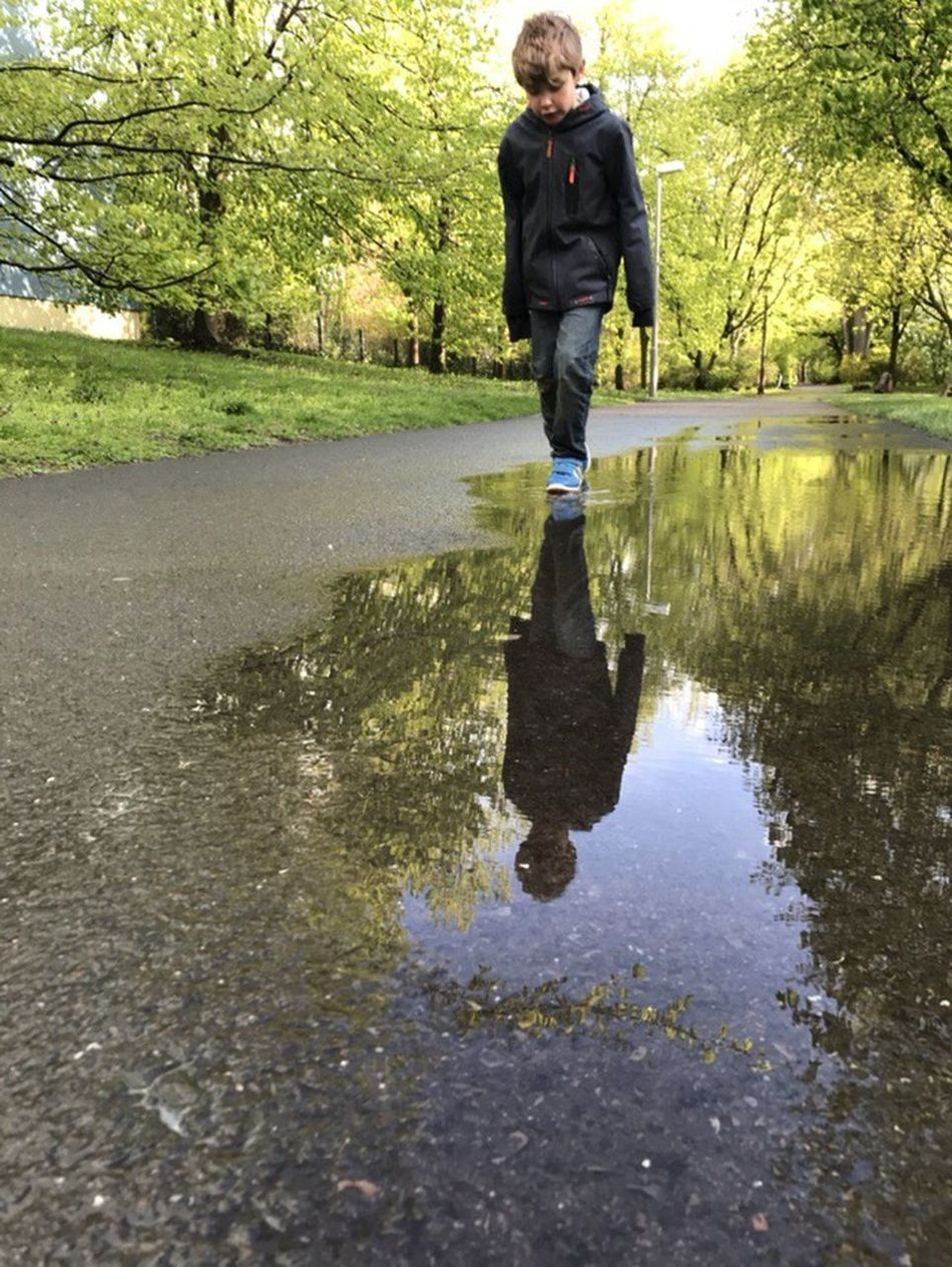 Playing after the rain Rain Puddle Puddleography Water Mirror Child Kids Playing Boy Park