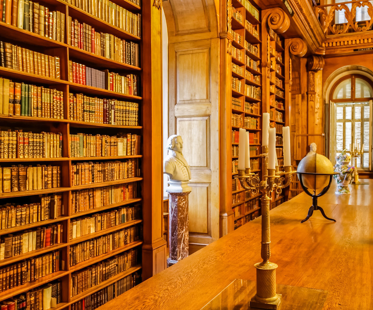 The library of an old European castle Art Books Building Built Structure Candles Day Globe History Illuminated Library No People Ornate Ornate Ceiling Shelves Tome Wood