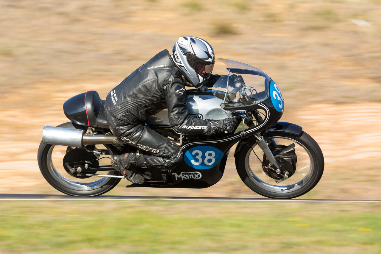 motorcycle, land vehicle, no people, outdoors, motorcycle racing, motorsport, stationary, day, close-up