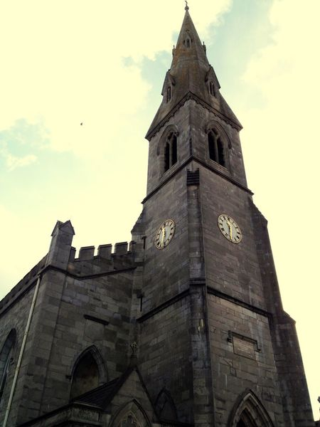 Religion Tower History Clock Tower Architecture Low Angle View Sky Building Exterior Place Of Worship Spirituality Outdoors Travel Destinations Day Built Structure No People Cloud - Sky Clock Time