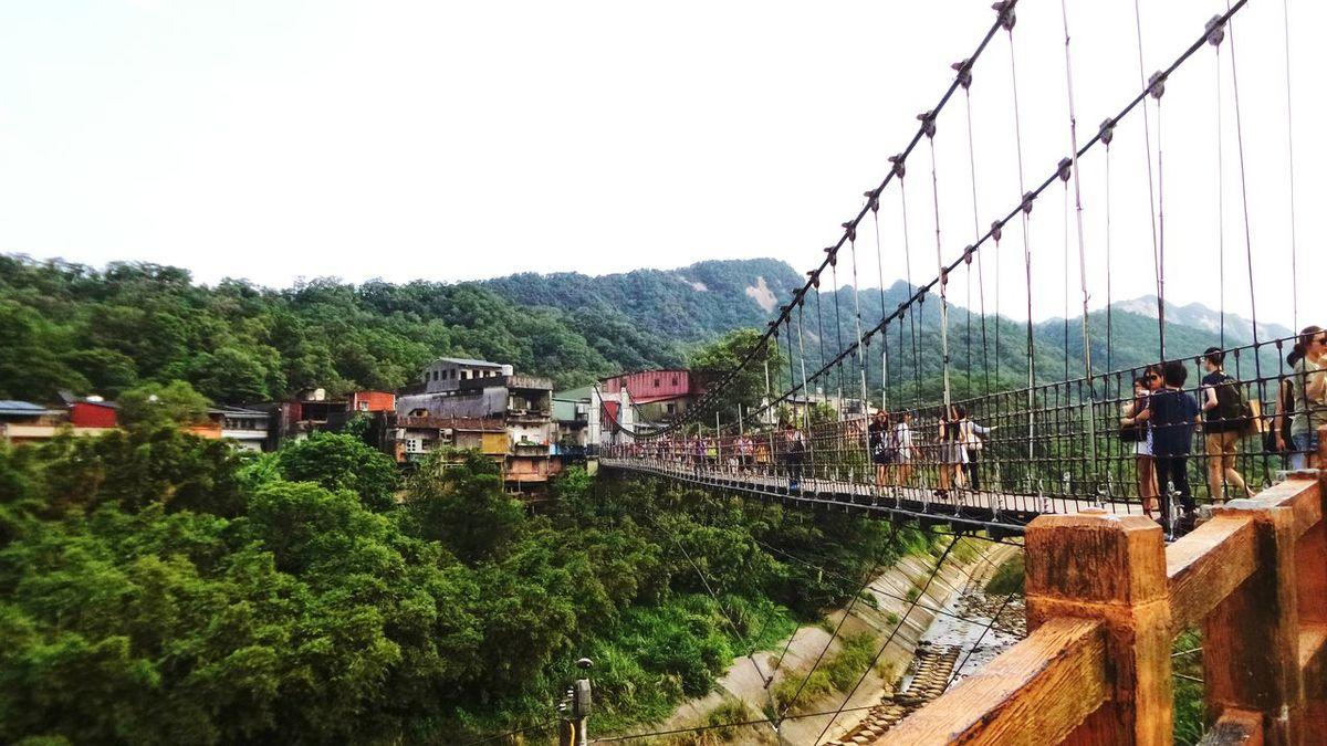 Crossing the suspension bridge at Shifen, Taiwan. 新北市平溪区十分站,过吊桥。 Bridge Suspension Bridge Taiwan Shifen Village Tourist Being A Tourist Tourists Holiday