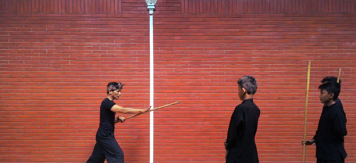 The Young Apprentices Brick Wall Disciples Leisure Activity Martial Arts Outdoors Pencak Silat Teacher Weapon