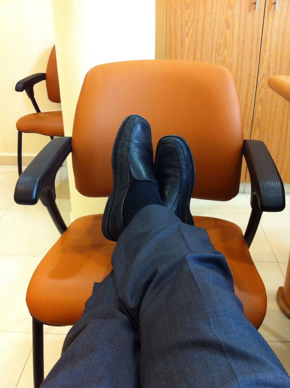 A Surgeon Having A Post Surgery Rest