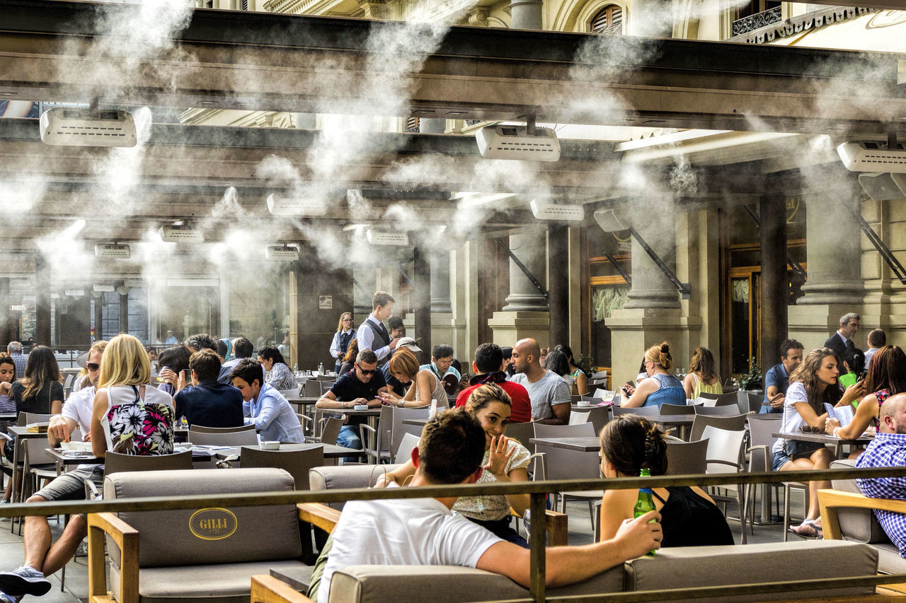 Air Conditioning Fog Indoors  Large Group Of People Lifestyles People Real People Restaurant Sitting