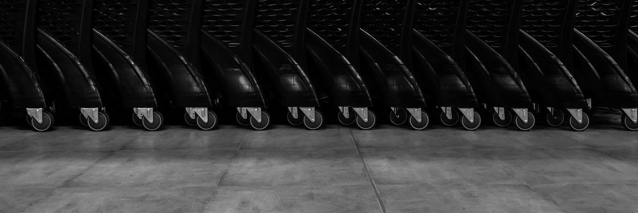 Dance of wheels Alligned Arrangement Day Decor Decoration In A Row Indoors  Interior Design Large Group Of Objects Military Neat No People Repetition Shop Shop Decoration Shopping Shopping Mall Store Store Decor Supermarket Symmetrical Symmetry Trolley Trolley Wheels Wheels BYOPaper! Let's Go. Together. Black And White Friday AI Now