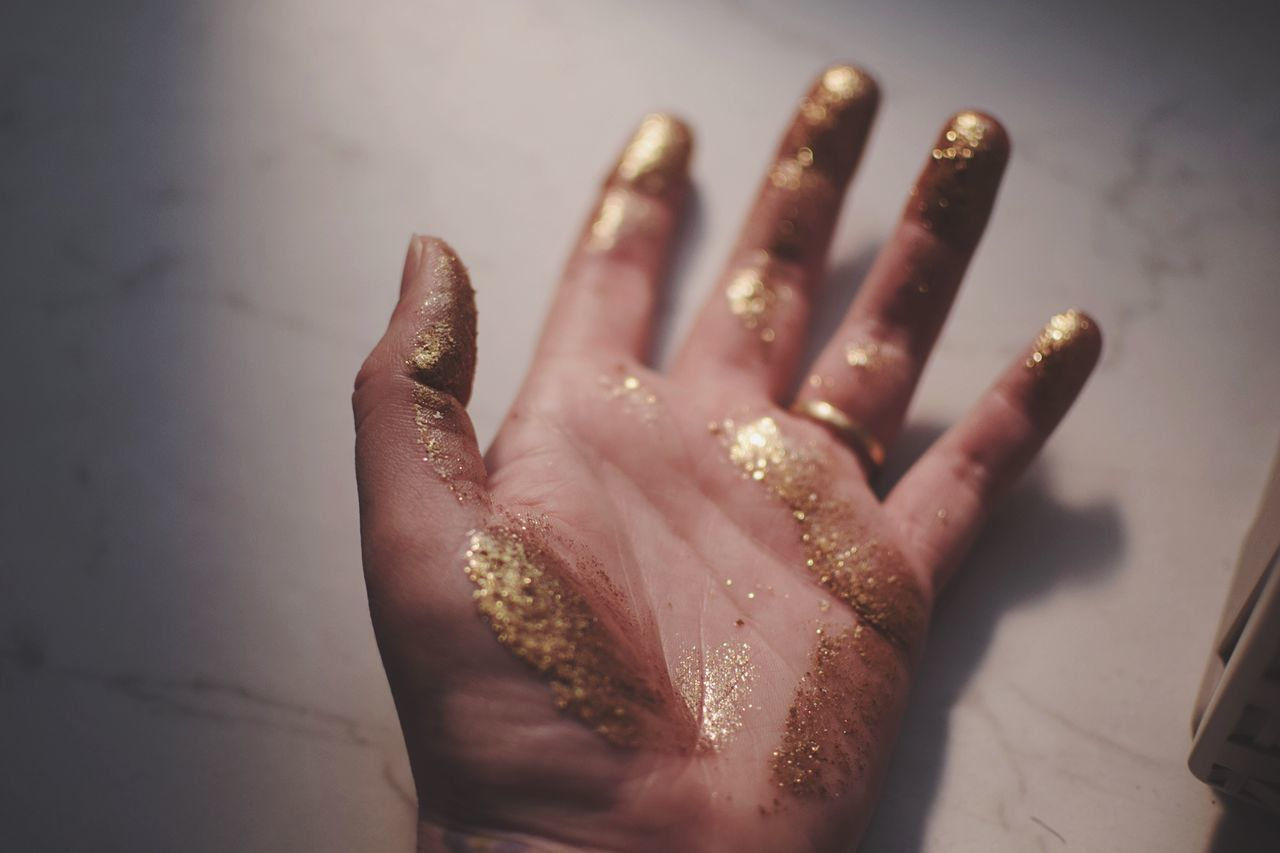 Gold finger. Human Hand Human Finger One Person Indoors  Human Body Part Close-up Palm Real People Day People Gold Gold Colored Glitter Golden Light And Shadow The Week On EyeEm