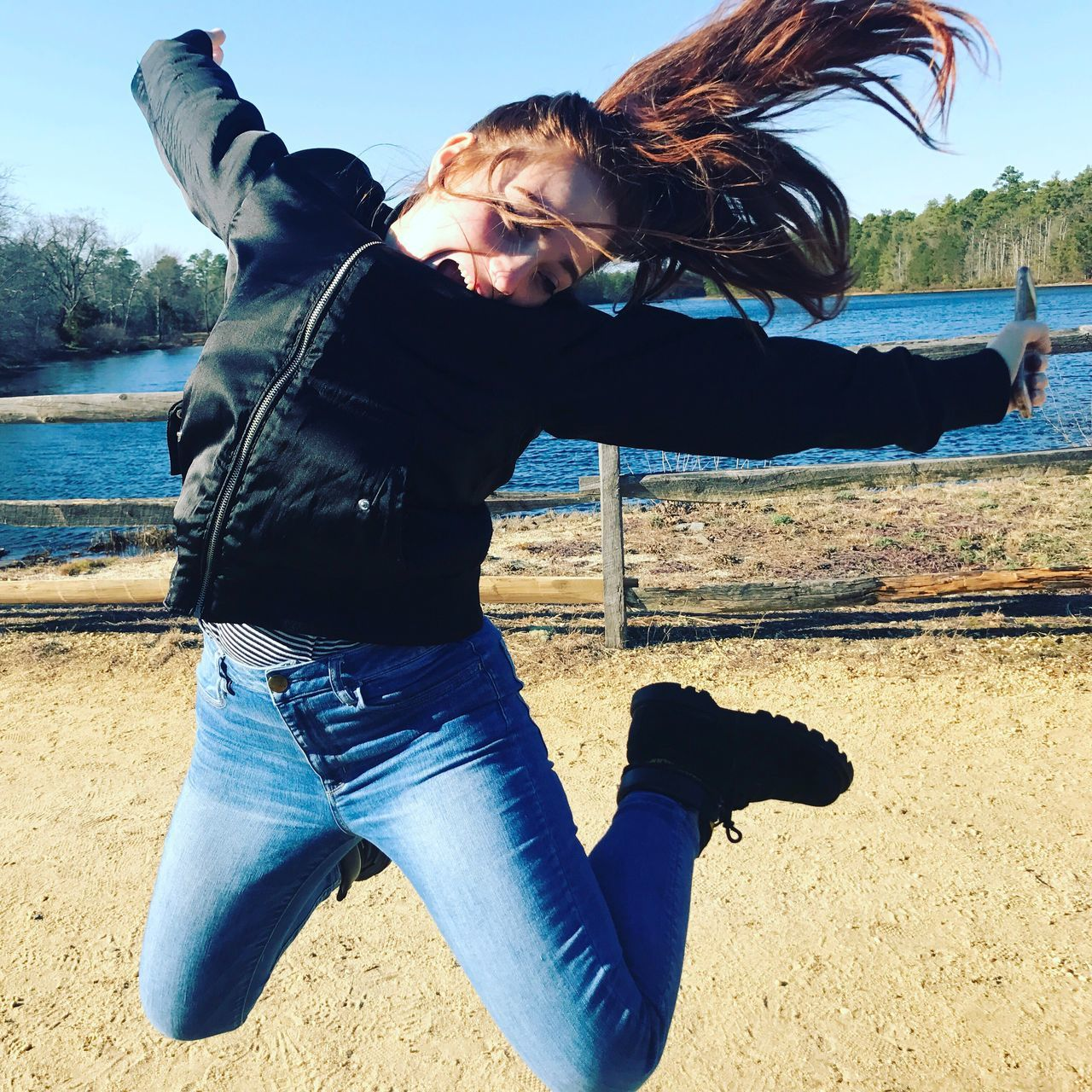 One Person Three Quarter Length Sunlight Casual Clothing Portrait Looking At Camera Outdoors Real People Lifestyles Beach Sky Young Adult Day Standing Water One Young Woman Only Jumpshot Jumping Jump Lake Lakefront Jump! Jumping For Joy EyeEmNewHere
