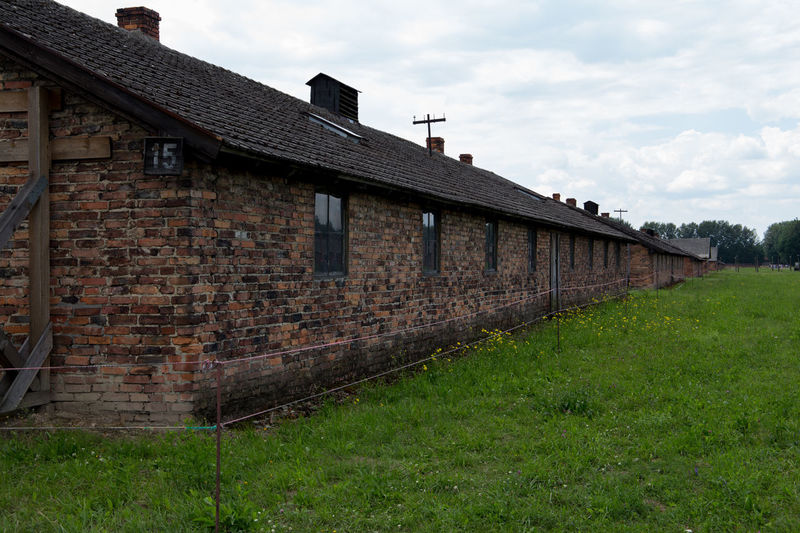 Aushwitz Aushwitz Residence Aushwitz-Birkenau Crakow Death Camp Eastern Europe Poland Architecture Aushwitz Camp Building Exterior Built Structure Cloud - Sky Concentration Camp Concentrationcamp Day Grass Killing Krakow Nature No People Outdoors Sad Sky