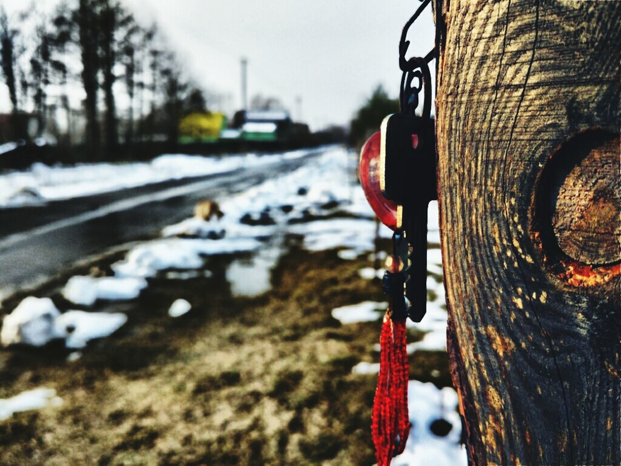 winter, snow, cold temperature, focus on foreground, close-up, mode of transport, outdoors, transportation, day, no people, car, land vehicle, red, hanging, nature, water, sky