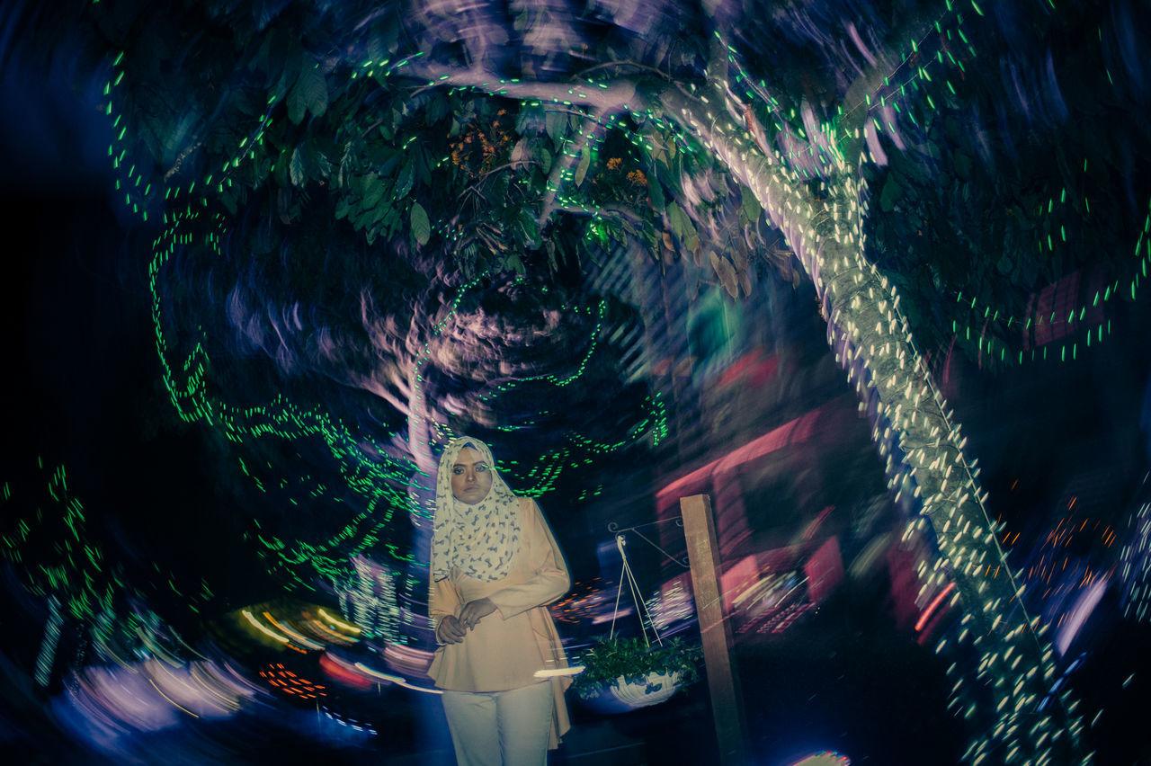 City Illuminated Motion Night Night Lights No People Outdoors Tree Young Women