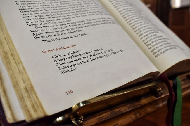 The word of God Australia Book Catholic Catholic Church Christianity Close-up Communication Education Extreme Close-up Focus On Foreground Heaven Lectionary Melbourne Message NikonD5500 Nikonphotography Old Open Page Paper Photography Sheet Music Text Western Script Word
