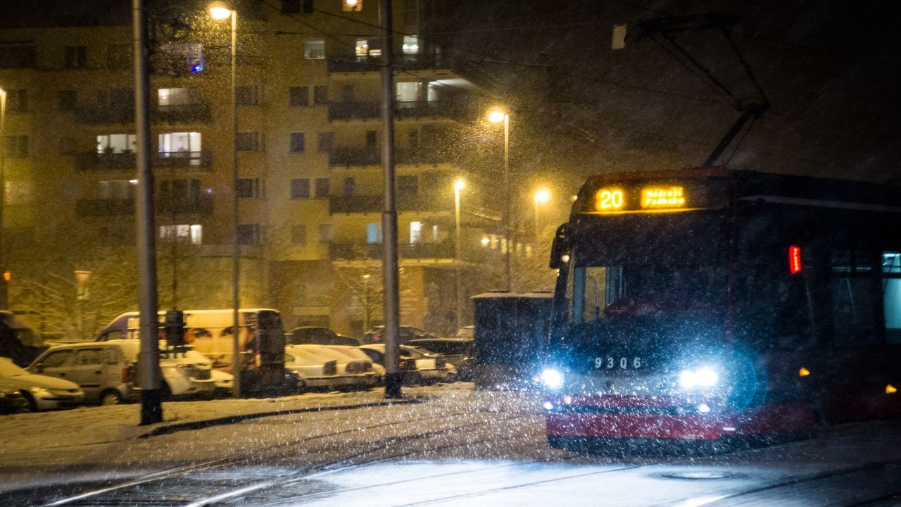 illuminated, night, winter, transportation, street, cold temperature, street light, snow, mode of transport, snowing, land vehicle, no people, road, outdoors, city, architecture