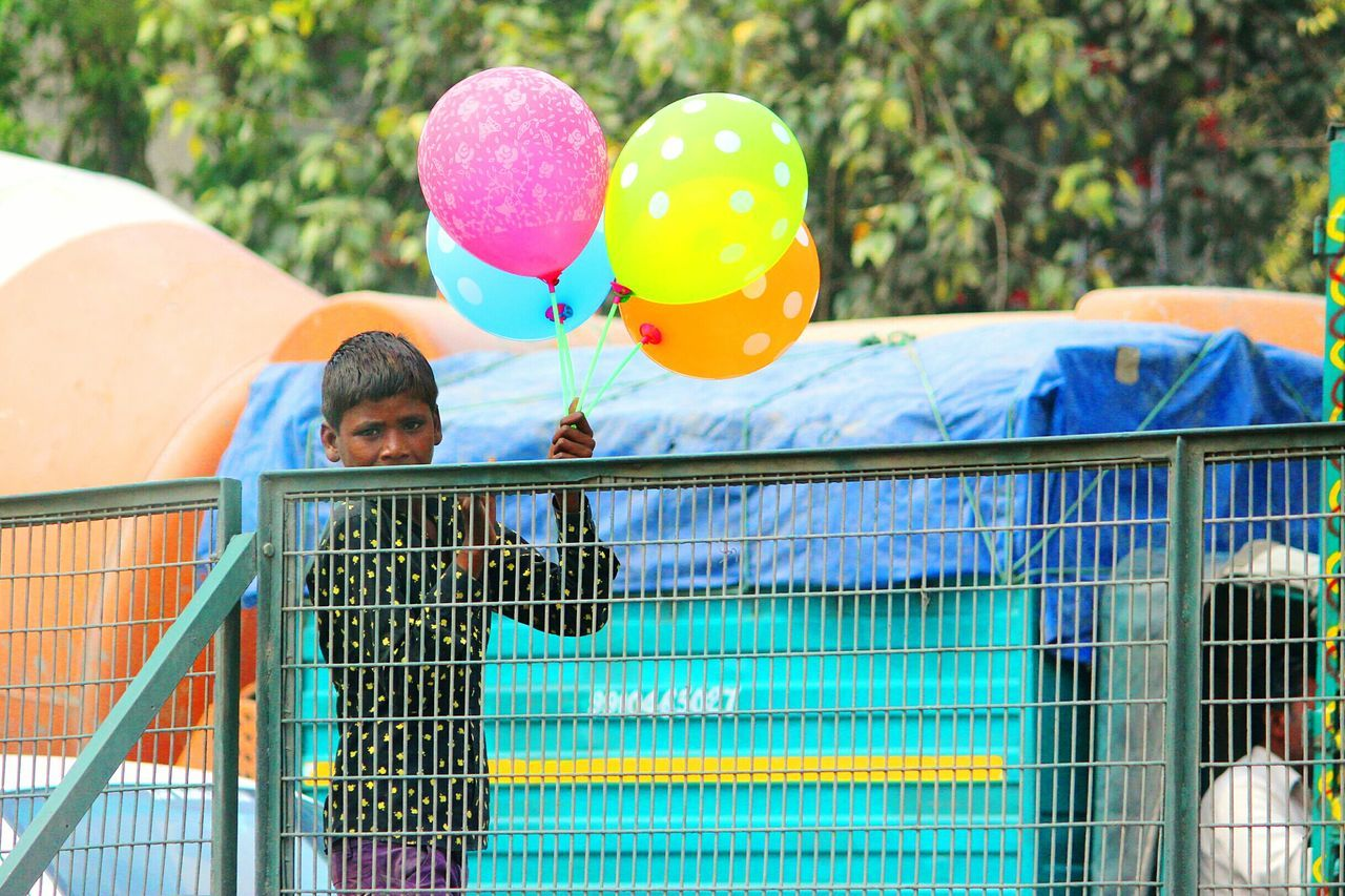 Struggle for the survival... Livelihood Struggle For Life Survival Ruined Childhood No Education Boy Kid Teenage Boy Selling Balloons On The Roads Poverty Self Dependent Working Hard Hopeful Intense Look Showcase March Telling Stories Differently