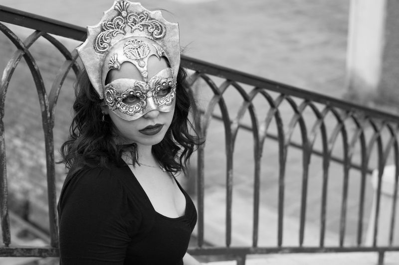 Black And White City Close-up Day Europe Focus On Foreground Iron Railings Italy Lifestyles Looking At Camera Mask One Person Outdoors Portrait Real People Travel Venetian Mask Venice Venice, Italy Water Young Adult Young Women