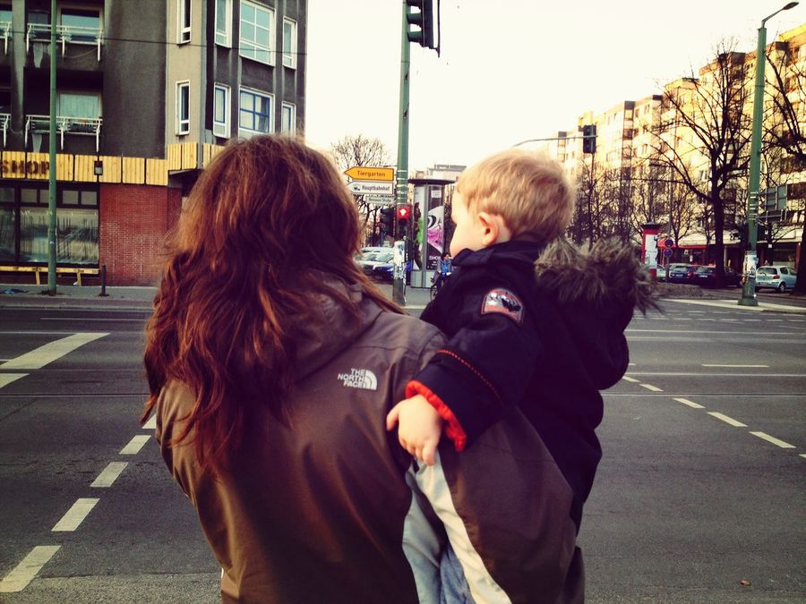 Mother And Son Waiting at a Traffic Signal