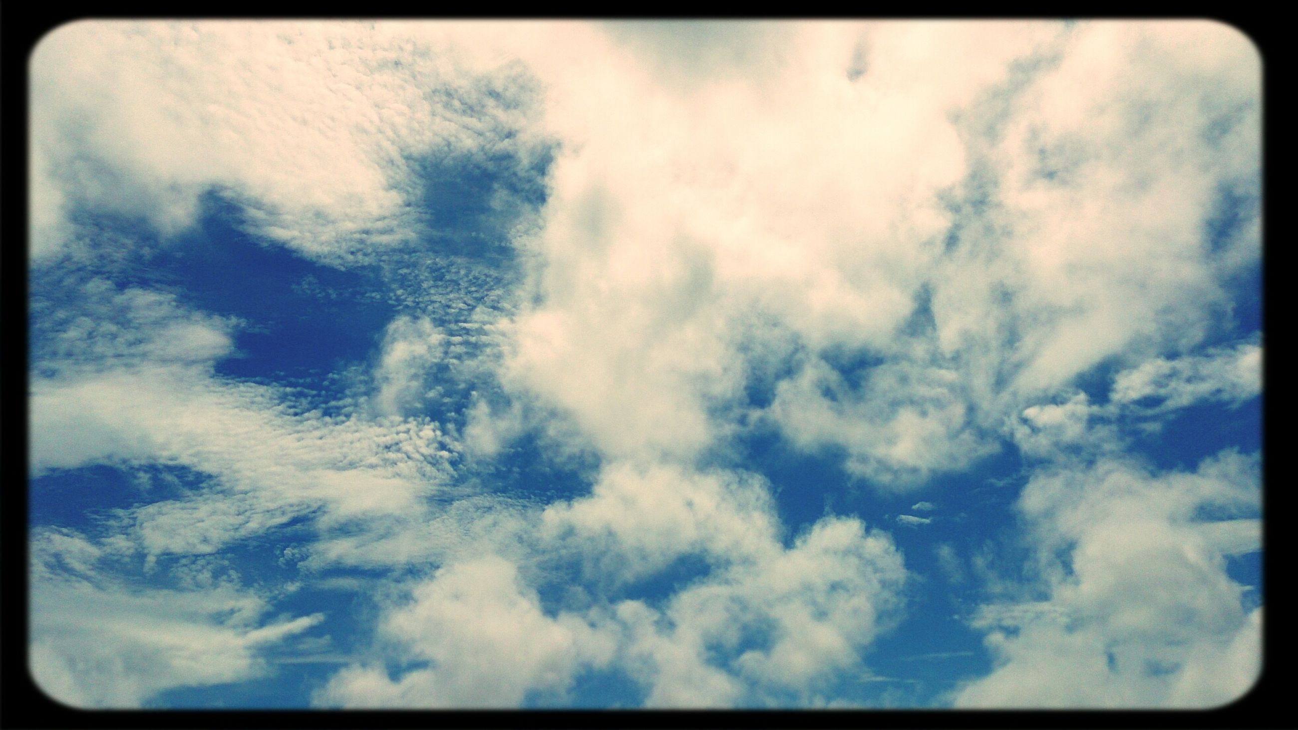 transfer print, auto post production filter, sky, cloud - sky, low angle view, sky only, backgrounds, beauty in nature, full frame, cloudy, nature, tranquility, scenics, cloudscape, blue, tranquil scene, cloud, white color, day, no people