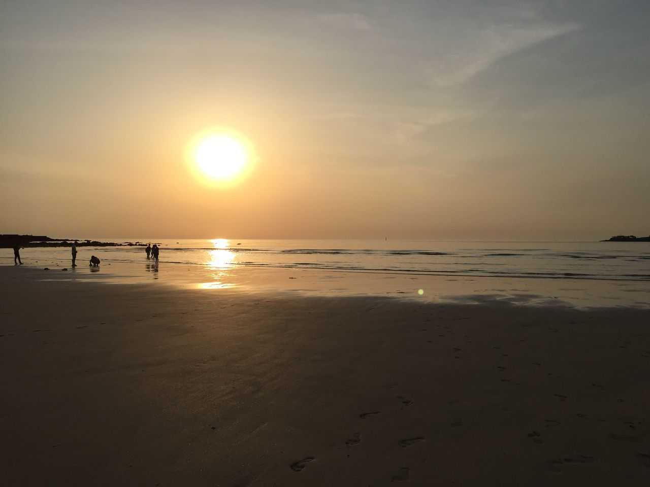 sunset, beach, sea, sun, sand, water, nature, scenics, shore, beauty in nature, tranquil scene, tranquility, sky, horizon over water, reflection, silhouette, outdoors, sunlight, wave, no people, day