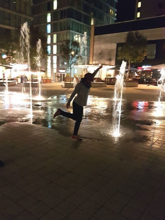 Wet Water Spraying Night Silhouette One Person Adult The Hub Fountain City Landscape Outdoors Lifestyles Jump joyful moment