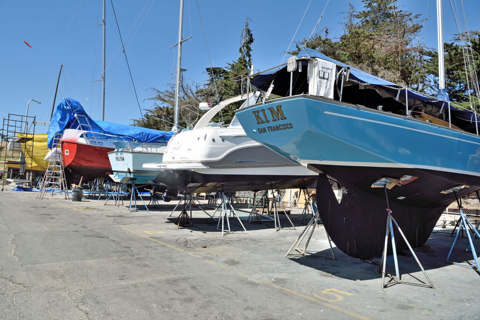 Boatyard @ Berkeley Marine Center 1 Berkeley, Ca. Boat Repair And Restoration Custom Yacht Builder Boats Boats On Stands Boat Masts Boat Hulls Scaffolding Ladders Tarps Boats In A Line Boatyard Colorful Boats Not Quite Ready For Water
