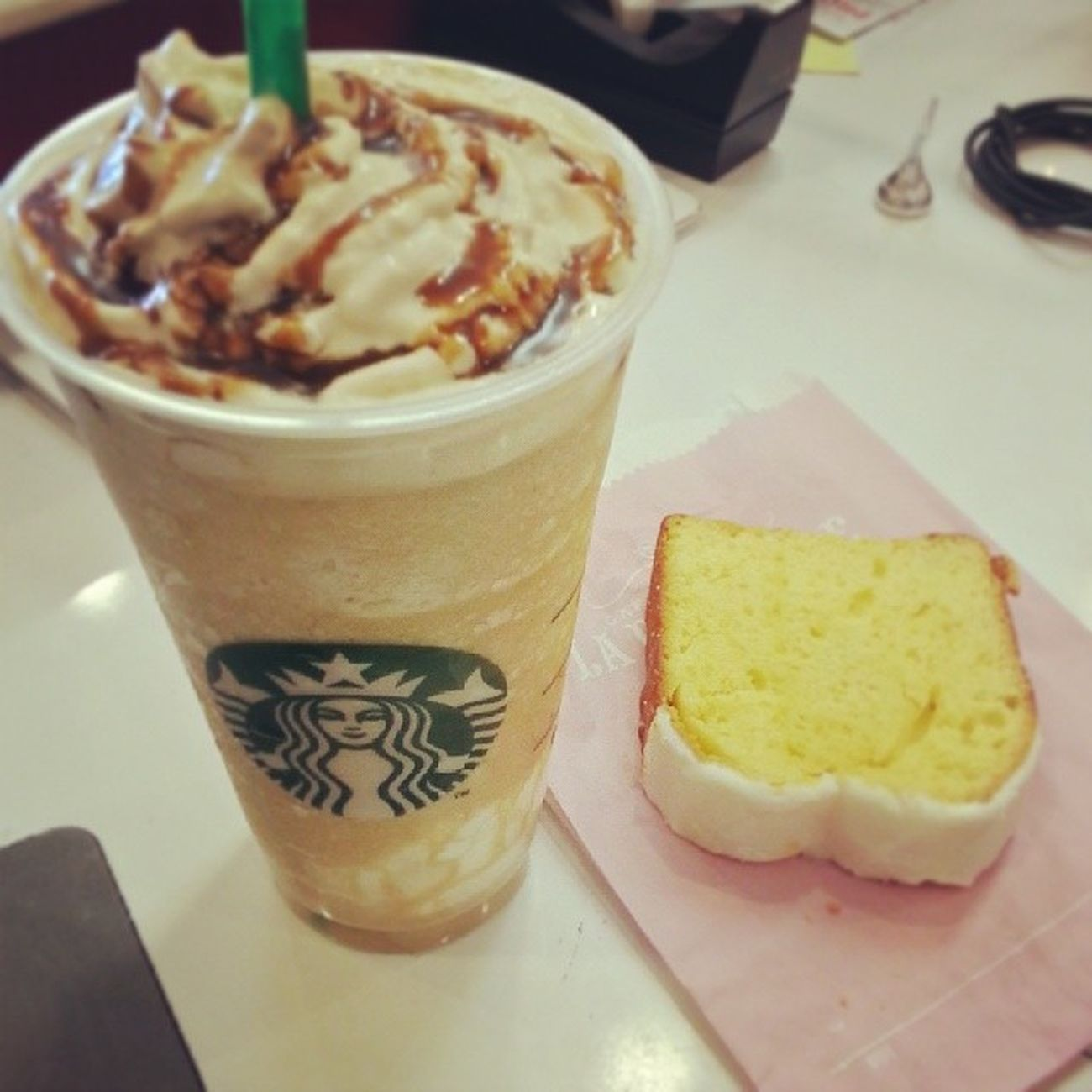 Cafe latte frappucino with lemon pound cake. :) Afternoondesert Frappucino Starbucks HALFOFFFRAPPUCINO