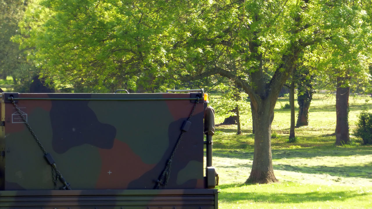 Military Vehicle Against Trees In Park