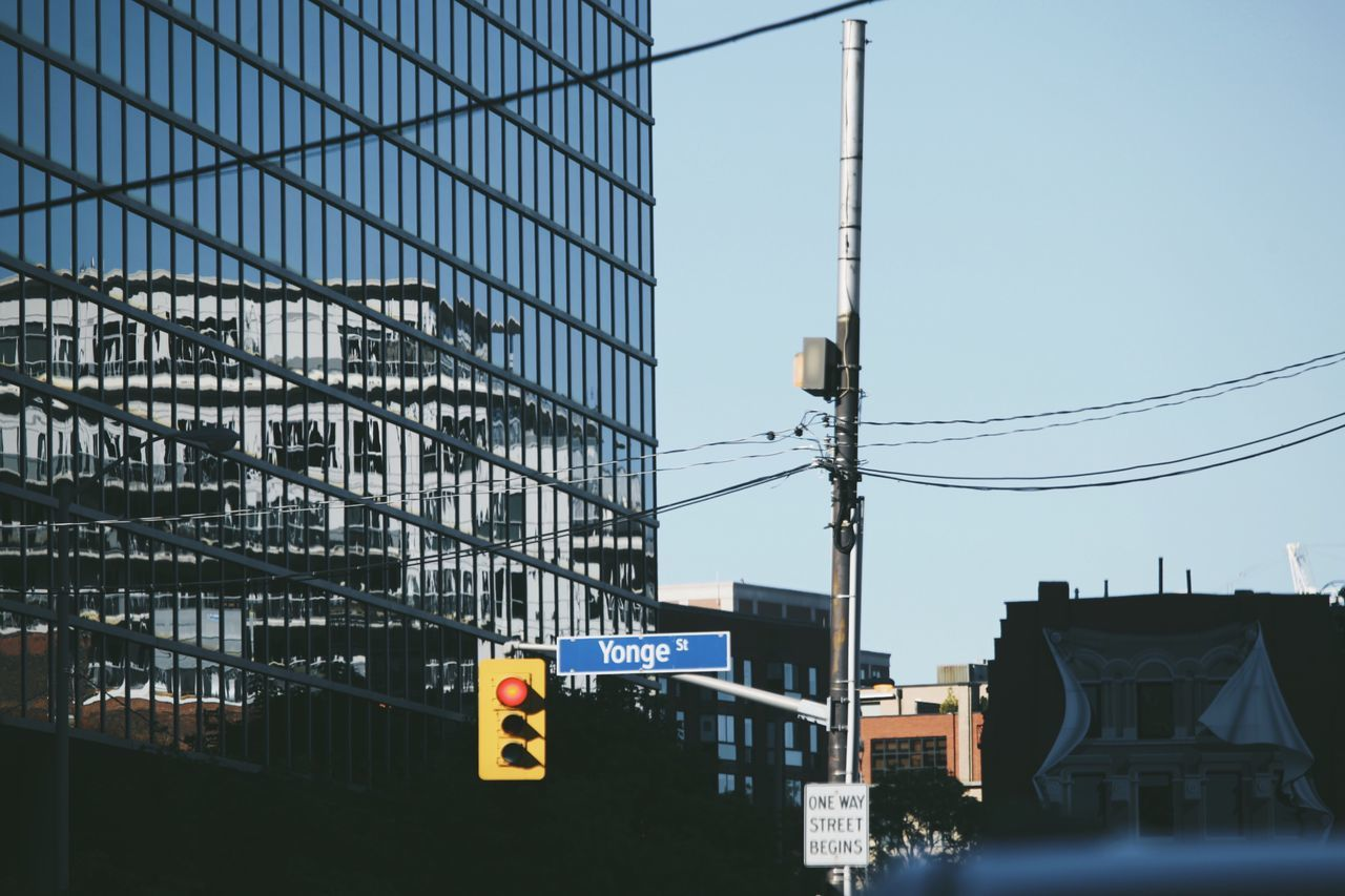 The Architect - 2017 EyeEm Awards Architecture Communication Built Structure Building Exterior Outdoors City Road Sign Day No People Sky Yonge Street Yongestreet Traffic Summer Reflection Building Buildings Open Edit Traffic Lights