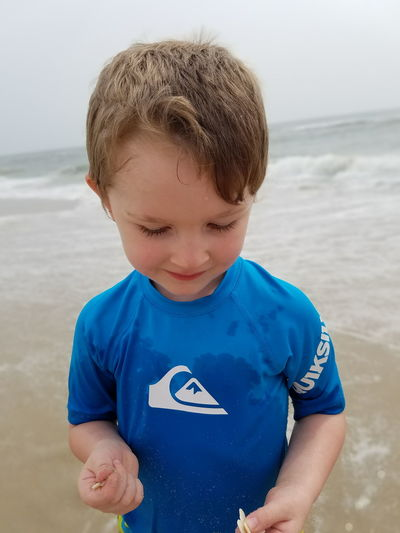 EyeEm Selects Beach Sea Boys One Boy Only Males  Child Waist Up Childhood Sand Children Only One Person Water Front View Blue Outdoors People Portrait Day Nature Close-up