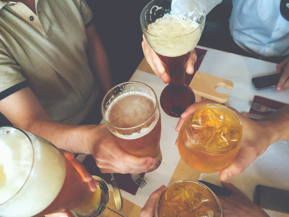 Alcohol Close-up Day Drink Drinking Glass Food And Drink Freshness Friendship Happy Hour High Angle View Holding Human Hand Indoors  Men People Real People Refreshment Table Togetherness Women