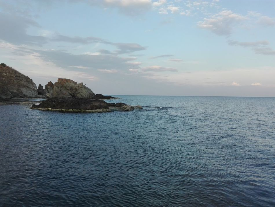 Clear sky over the sea Beauty In Nature Calm Cliff Cloud - Sky Day Horizon Over Water Majestic Nature Non-urban Scene Outdoors Remote Rocky Shore Rocky Shore By The Sea Rocky Shoreline Rocky Shorelines Scenics Sea Sea And Rocks Seascape Sky Tranquil Scene Tranquility Vacations Water Waterfront