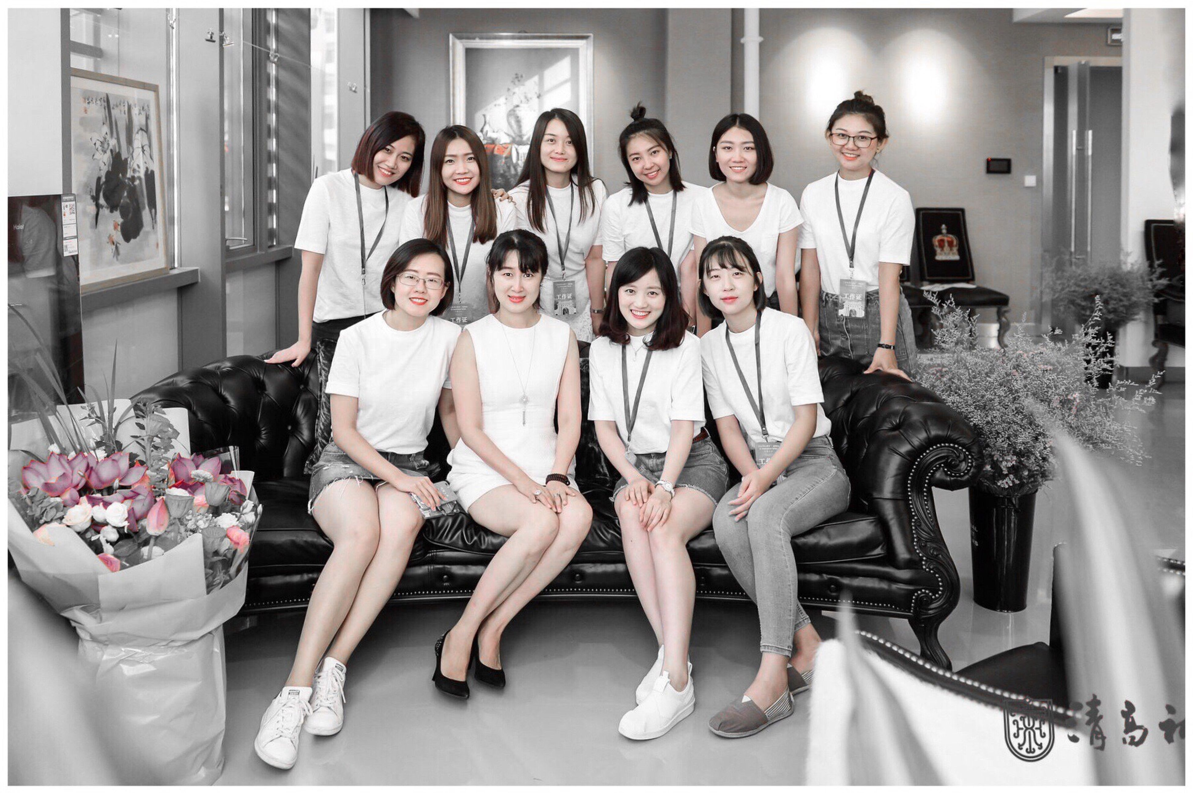 looking at camera, portrait, smiling, wellbeing, front view, indoors, cheerful, happiness, fashion, women, enjoyment, men, full length, togetherness, standing, body care, beautiful woman, young adult, lifestyles, large group of people, beauty, well-dressed, young women, health club, adult, day, people, adults only