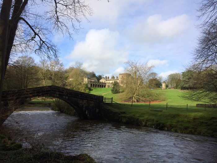 Tree Sky Bare Tree Cloud - Sky Water Built Structure Day Architecture Outdoors No People Nature River Bridge - Man Made Structure Tranquility Beauty In Nature Scenics Building Exterior Footbridge Beautiful Location 💕 Ilam Hall